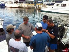 Discussion of EVA procedures before the splash down boat leaves shore.