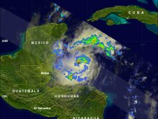 On Oct. 26 at 12:18 p.m. EDT TRMM noticed areas of heavy rainfall north of Hurricane Rina's eye.
