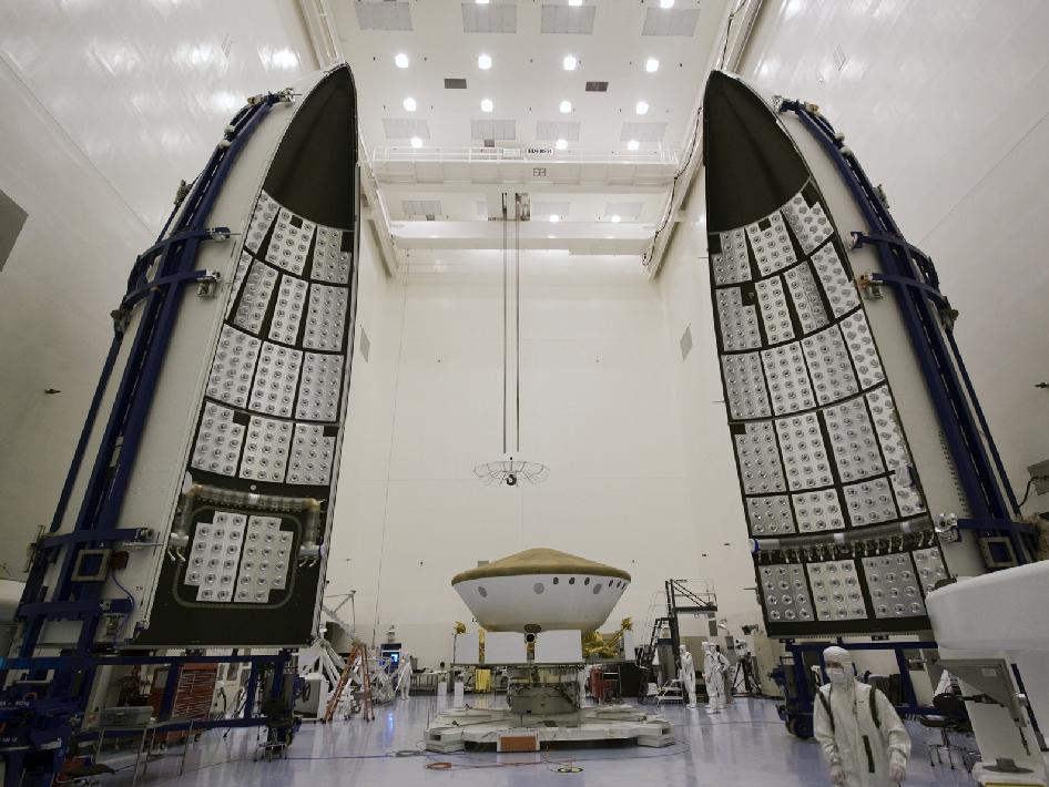 Preparations are under way to enclose NASA's Mars Science Laboratory in an Atlas V rocket payload fairing