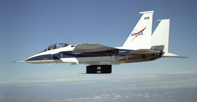 F-15B flight research test bed carries shuttle thermal insulation panels on its underbelly flight text fixture.