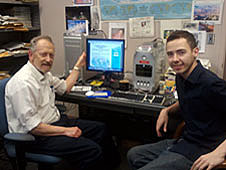 Leonard Druyan and Crae Sosa sitting at a desk with a computer