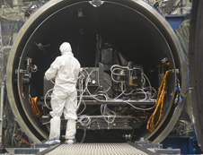 Technician surveys the TIRS instrument