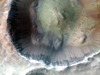 Impact cratering and erosion combine to reveal the composition of the Martian underground