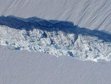 A close-up image of the crack spreading across the ice shelf of Pine Island Glacier shows the details of the boulder-like blocks of ice that fell into the rift when it split.