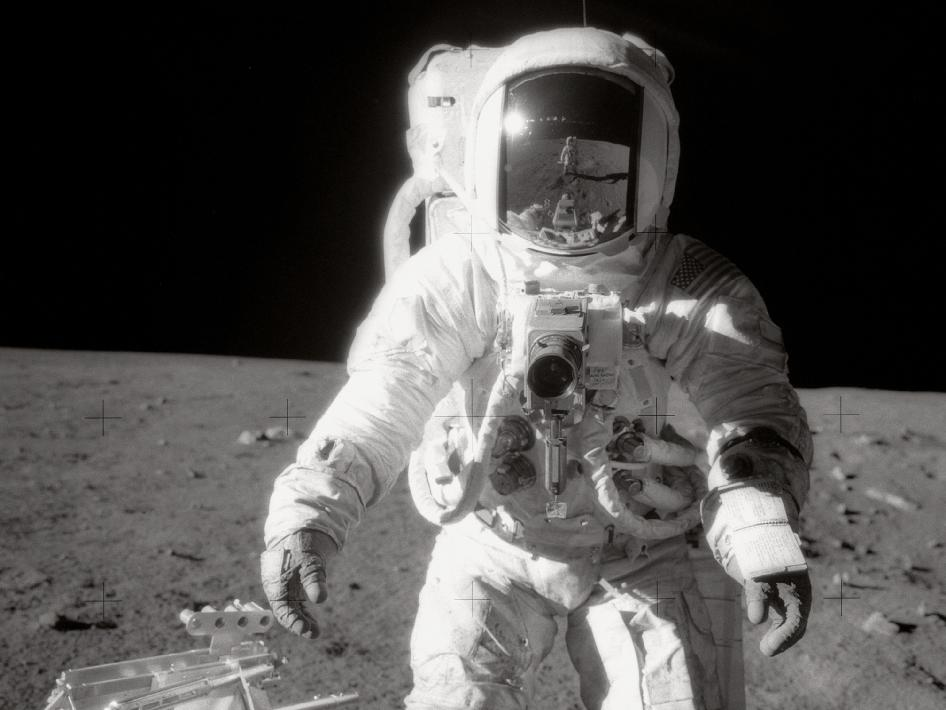 Astronaut Alan L. Bean walks on the moon during Apollo 12.