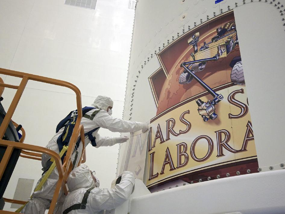 The Mars Science Laboratory mission logo is applied to the exterior of the payload fairing