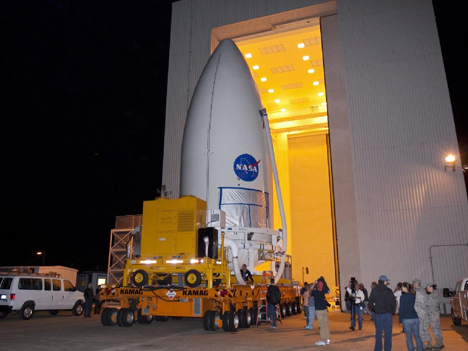 The payload fairing containing MSL rolls out of the Payload Hazardous Servicing Facility