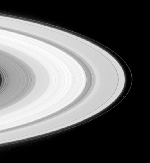 Saturn's moon Prometheus is seen orbiting inside the planet's F-ring