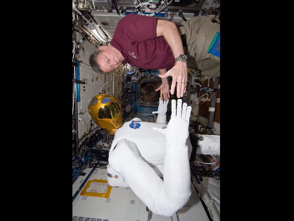 NASA astronaut Mike Fossum and Robonaut 2