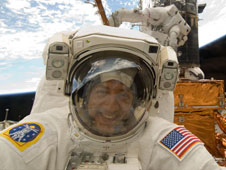 Astronaut Mike Massimino in spacesuit