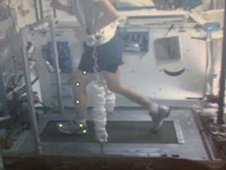Image taken from video captures a crew member's Treadmill Kinematics session showing marker locations and the attachment point of the bungee system to the surface