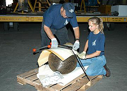 Pieces of Columbia debris being packed up for shipment to The Aerospace Corporation.