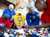 Leland Melvin, NASA's associate administrator of education, and Stephen Turnipseed, president of LEGO Education North America, look on as students work with LEGO bricks. (NASA)