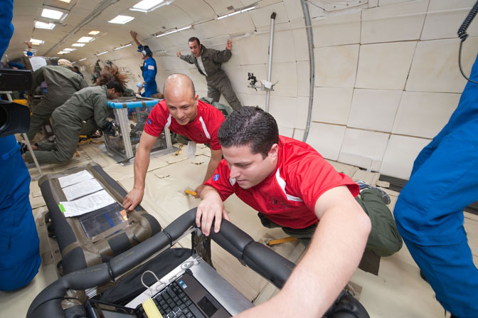 University of Puerto Rico, Rio Piedras student researchers, Carlos Poventud and Eduardo Nicolau running their experiment aboard an aircraft flying parabolic arcs to simulate microgravity during NASA first Minority Serving Institutions and Community Colleges Reduced Gravity Flight Week.