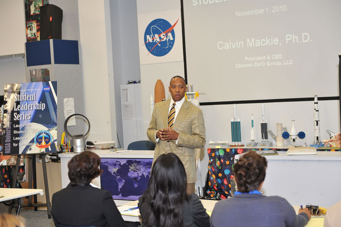 Dr. Calvin Mackie, author, professor and inventor, addresses student researchers and faculty, from the 13 University Research Centers gathered at Kennedy Space Center, on the topic of Changing Lives and Realities at the Student Leadership Series Inaugural Kickoff , June 2010.