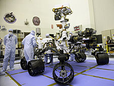Workers examine the MSL
