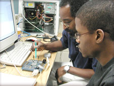 CESET researchers performing a test on a circuit board