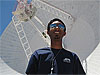 Deepak Atyam in front of a large radio telescope