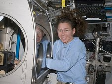 Astronaut Sandra Magnus works with the Smoke Point In Co-flow Experiment (SPICE) in the Microgravity Sciences Glovebox (MSG) during Expedition 18.