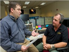 Jason Norwood, left, a payload operations director at the Marshall Center, goes over procedures with NASA astronaut TJ Creamer during a training session in the Payload Operations Center