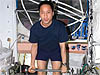 Astronaut Ed Lu exercises on the space station