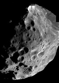 In this mosaic of high resolution images, Phoebe shows an unusual variation in brightness over its surface