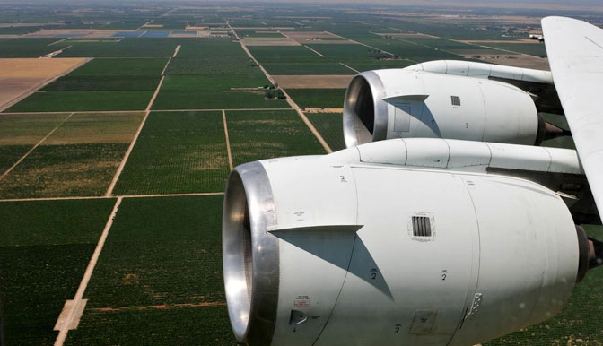 NASAs DC-8 airborne science laboratory flew low over San Joaquin Valley farm fields while specialized instruments collected data during the vegetation canopy and soil moisture study.