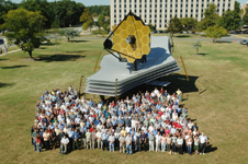 Goddard staff surround a full-size model of Webb