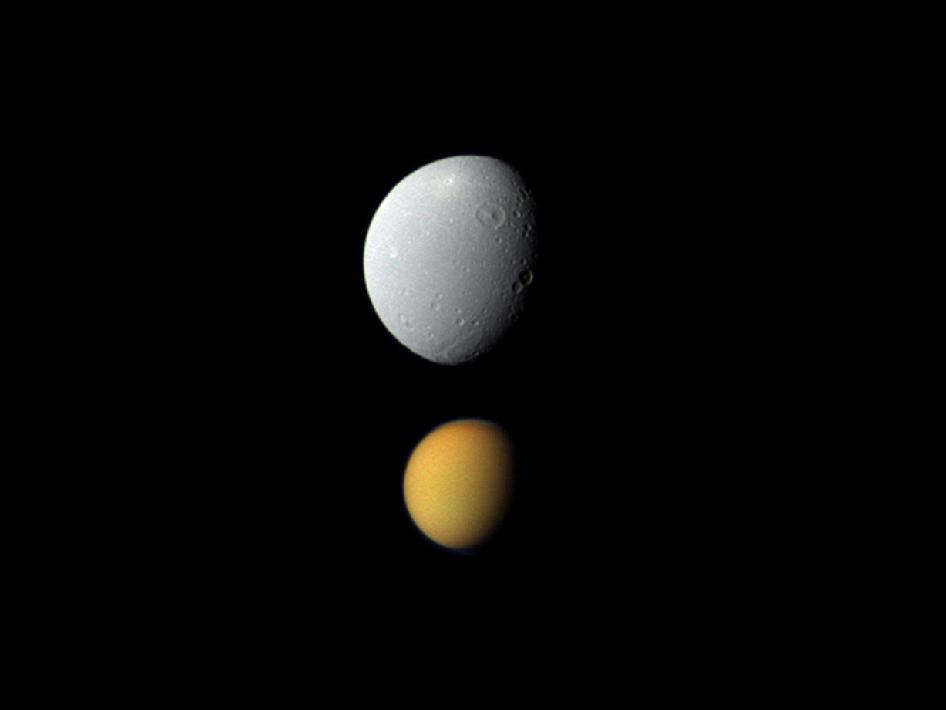 Saturn's largest moon, Titan, with Dione