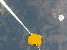 A picture of a yellow box high over Earth