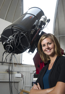 Rhiannon Blaauw next to a large telescope