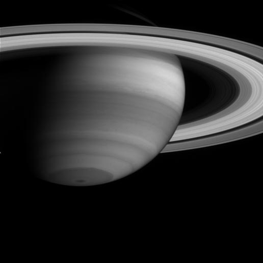 In this image, dark regions represent areas where Cassini is seeing into deeper levels in Saturn's atmosphere