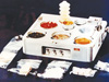 Skylab food heating and serving tray with food, drink, and utensils