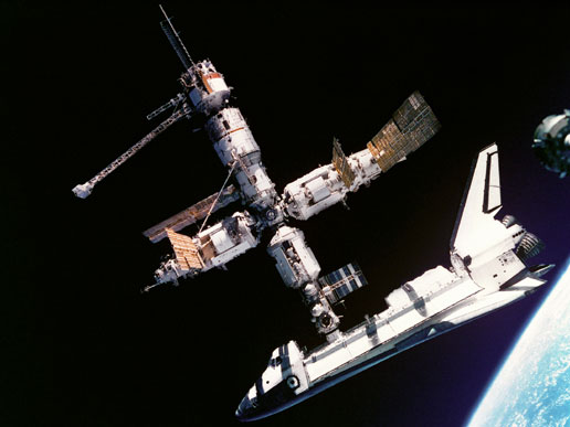 the Space Shuttle Atlantis docked with the Russian space station Mir