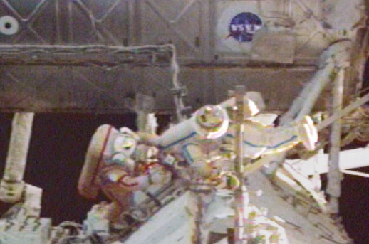 Spacewalkers Gennady Padalka and Mike Fincke work at the Station's S0 Truss to restore power to a Control Moment Gyro.
