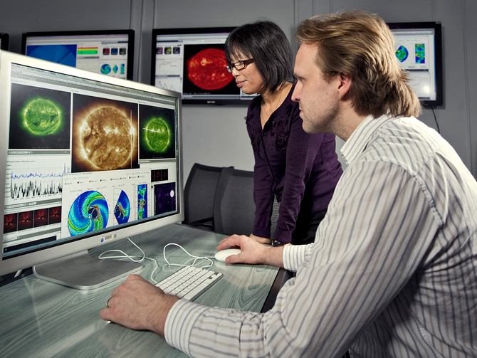 Yihua Zheng and Antti Pulkkinen monitor space weather for Goddard's Space Weather Center.