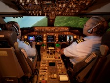 Pilots on the flight deck of NASA's Boeing 747-400 simulator during the TBAS-ET simulation