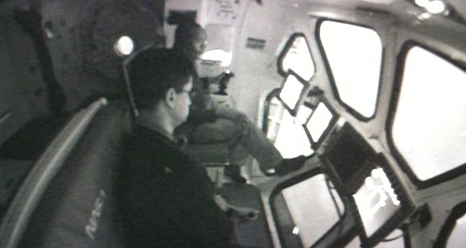 Crewmates José Hurtado and Alvin Drew conduct an MMSEV flying simulation.