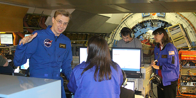 SOFIA staff scientist James De Buizer (left) discusses an infrared image.