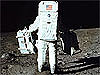 Astronaut Buzz Aldrin carrying equipment on the moon