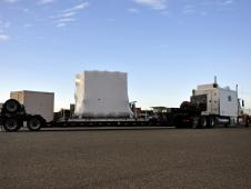 Spacecraft arrives by truck.