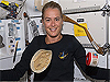 A tortilla and jar float by a woman inside the space shuttle
