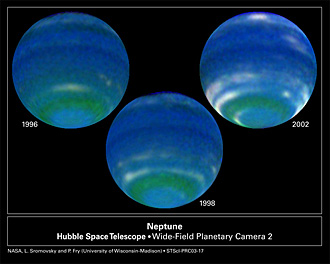 Three color images of blue-green planet Neptune taken from 1996 to 2002. Increased clouds in 1998 and 2002 are a sign of seasonal change on the gas planet.