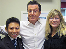 Stephen Colbert (center), flanked by Jason Lou (left) and Lisa Scott-Carnell