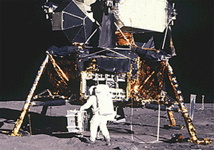 Buzz Aldrin standing on the moon in front of the Lunar Module named Eagle