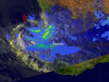 Bands of heavy rainfall (in red) measuring over 50mm/hr were hitting coastal areas northwest of Perth, Australia.
