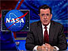 Stephen Colbert next to a NASA logo
