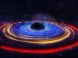 An image of a black hole with surrounding energetic disk of material in multicolored bands of blue, yellow and red, on a black background.