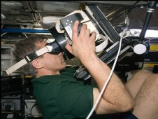 Canadian Space Agency astronaut Robert Thirsk uses Neurospat hardware to perform the Bodies in the Space Environment experiment. (NASA)