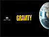 The space shuttle and Earth with the word Gravity between
